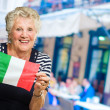 Portrait Of A Elderly Woman Holding Flag — Stock Photo #11658734