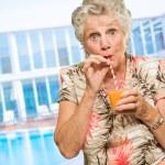 Portrait Of A Elderly Woman Drinking Juice — Stock Photo #11658745