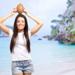 Woman On A Beach With Coconut On Head — Stock Photo #11658871