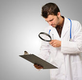 Portrait Of A Doctor With Manifying Glass — Stock Photo