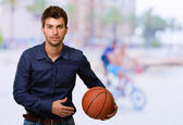 Portrait Of Young Man Holding Basketball — Stock Photo