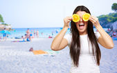 Woman On A Beach Covering Eyes With Lemon — Stock Photo