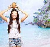 Woman On A Beach With Coconut On Head — Stock Photo