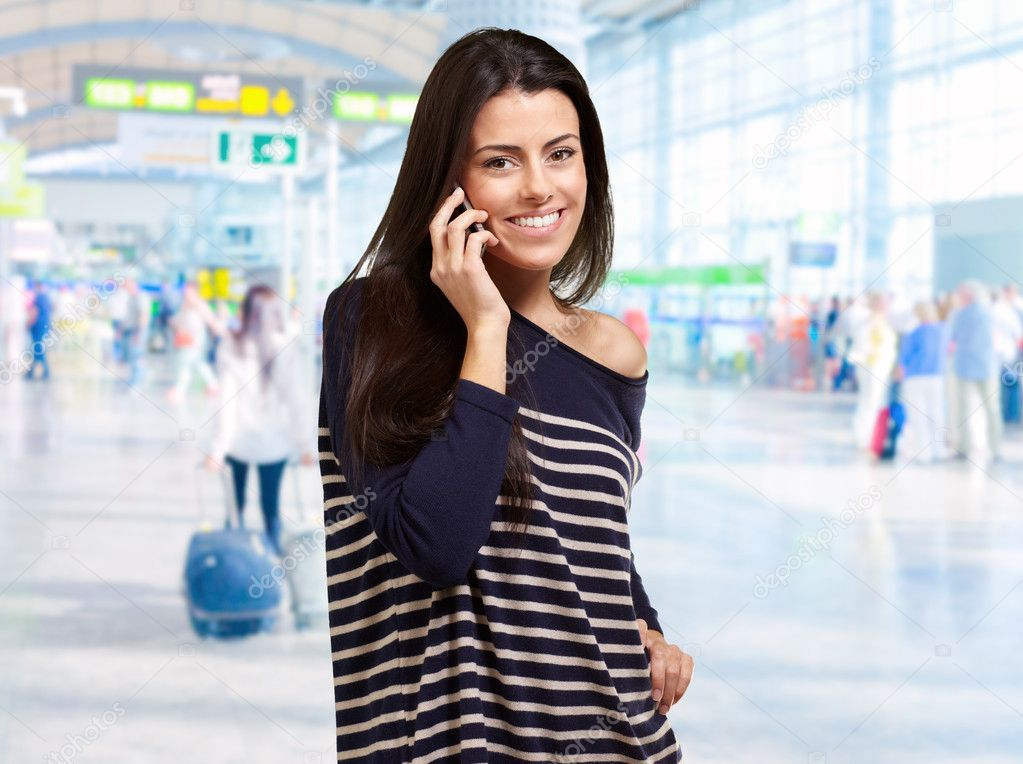 Portrait Of A Woman Talking At Airport, Outdoor — Stock Photo #11658877