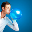 Portrait Of Young Man BlowingBalloon — Stock Photo