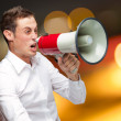 Portrait Of Young Man Shouting On Megaphone — Stock Photo #11959642