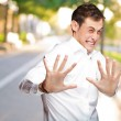 A Young Man Holding His Hands Out In Fear — Stock Photo #11959689