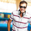 Stock Photo: Portrait Of A Handsome Young Man Listening To Music