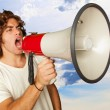 Portrait Of A Handsome Young Man Shouting With Megaphone — Stock Photo #11959963
