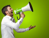 Portrait Of A Man Yelling Into A Megaphone — Stock Photo