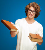 Portrait Of A Young Student Holding Books — Stock Photo
