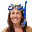 Portrait of a happy middle aged woman wearing snorkel and goggle — Stock Photo #11961092