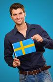 Potrait of a man holding flag — Stock Photo