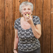 Mature Woman Eating — Stock Photo