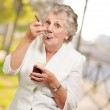 Mature Woman Standing And Taking Healthy Drink — Stock Photo #11990372
