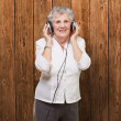 Portrait Of A Woman, While Listening Music — Stock Photo #11990377
