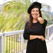Happy Woman Showing Thumb Up - Stock Photo