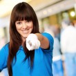 Women pointing with hand on hip — Stock Photo