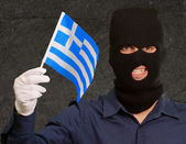 Portrait of a man wearing mask holding a flag — Stock Photo
