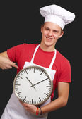 Portrait Of A Young Man Holding A Clock — Stock Photo