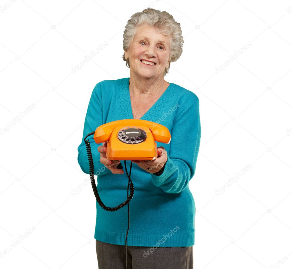 Mature Happy Woman Holding Telephone On White Background  Stock Photo #11990460