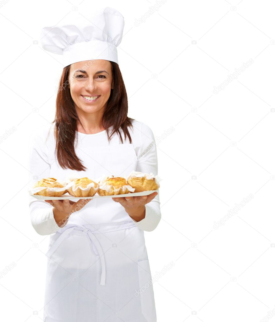 Woman chef holding baked food on white background — Stock Photo #11990733