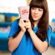 Girl holding empty popcorn packet — Stock Photo #12048161