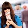 Girl holding empty popcorn packet — Stock Photo #12048182