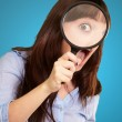 Woman Holding Magnifying Glass — Stock Photo #12048366