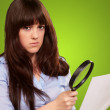 Portrait Of A Girl Holding A Magnifying Glass And Paper — Stock Photo #12048374