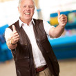 A Senior Man Showing Thumbs Up — Stock Photo #12048499