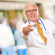 Portrait Of A Senior Doctor Pointing — Stock Photo #12048529