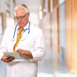 Portrait Of A Male Doctor Holding A Tab — Stock Photo #12048550