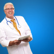 Portrait Of A Male Doctor Holding A Tab — Stock Photo #12048558