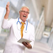 Doctor Holding A Tablet And Happy — Stock Photo #12048588
