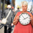 Senior Woman Holding A Clock — Stock Photo