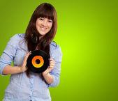 Portrait d'une femme tenant un disque — Photo