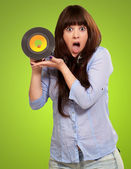 Shock Girl Showing Vinyl — Stock Photo