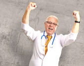 Senior Male Doctor In A Winning Gesture — Stok fotoğraf