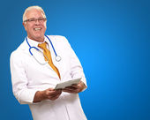 Portrait Of A Male Doctor Holding A Tab — Stock Photo