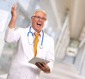 Doctor Holding A Tablet And Happy — Stock Photo