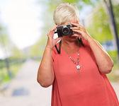 Senior Woman Clicking Photo — Stock Photo