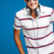 Portrait Of A Handsome Young Man Listening To Music — Stock Photo #12093169