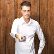 Man Holding Remote In His Hand — Stock Photo #12093180