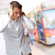 Portrait Of Young Man Covering His Ears With Hand — Stock Photo #12093188