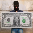 Man wearing mask holding american note — ストック写真