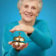 Happy Mature Woman While Holding Bell — Stock Photo
