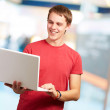 Happy man using laptop — Stock Photo #12093931