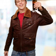 Portrait of young man holding beer indoor — Stock Photo #12094193