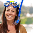 Portrait of a happy middle aged woman wearing snorkel and goggle — Stock Photo #12094348